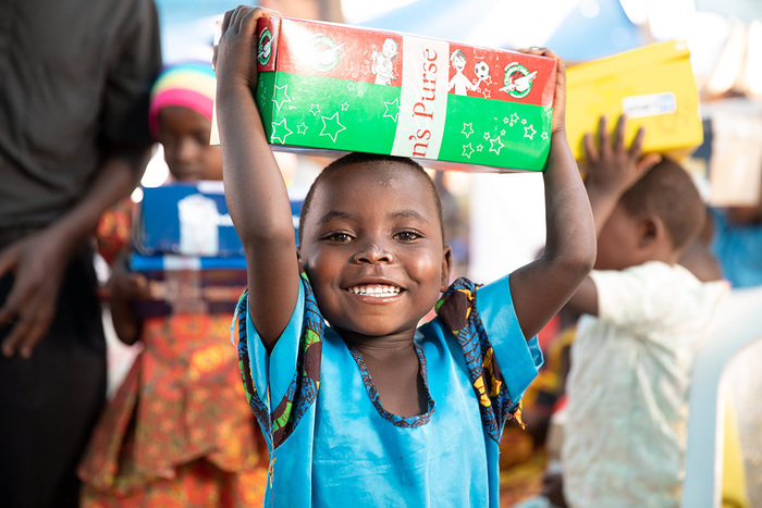 Child receiving a shoebox from Samaritan's Purse Operation Christmas Child