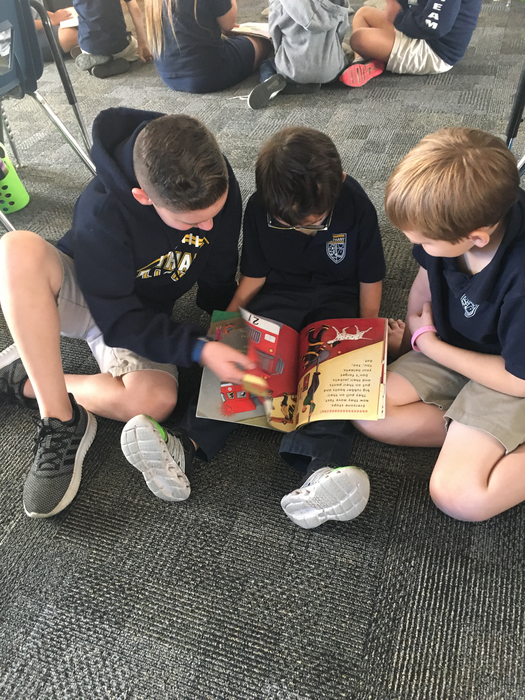 Ryan, Tommy and Max enjoy reading together:)