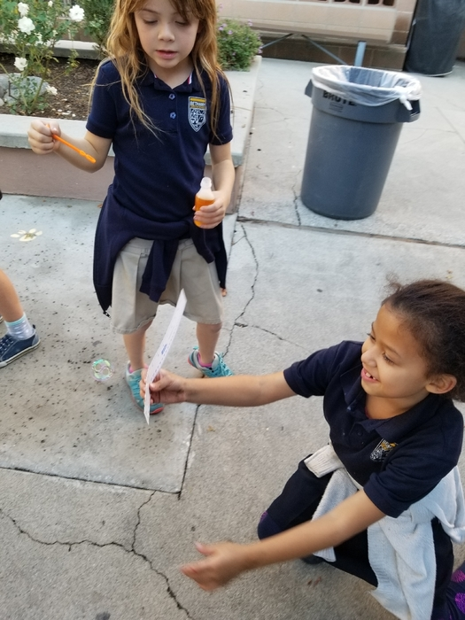 The students took turns blowing bubbles while their partner tried to measure them.