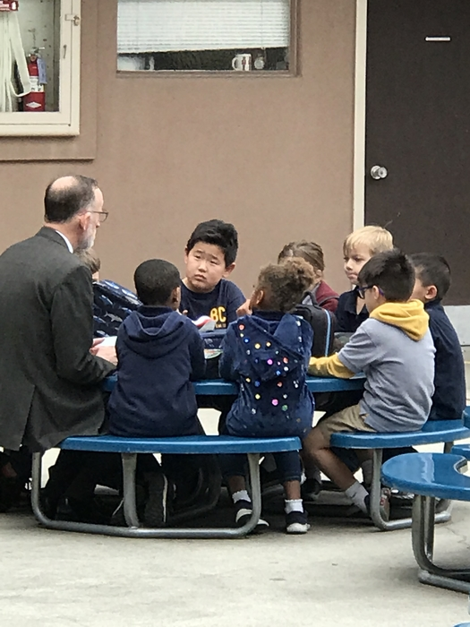 Dr. Walner meets with lower elementary students.