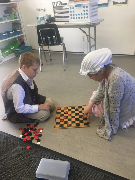 Ben and Londyn play checkers.