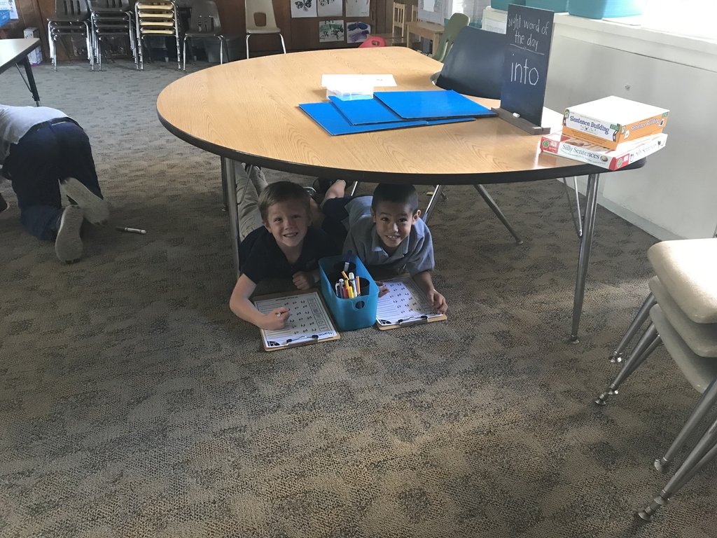 Letter U: under day!  Today we did our work under our desks!