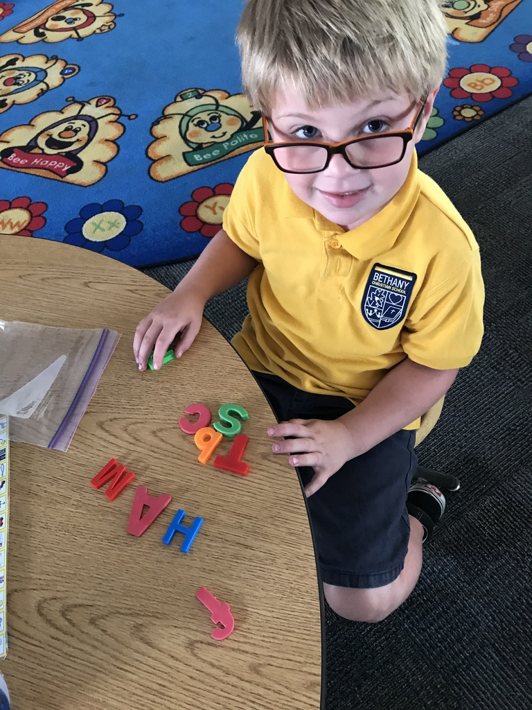 The kindergarteners are learning the -at word family. So we thought we'd practice spelling them using alphabet magnets!