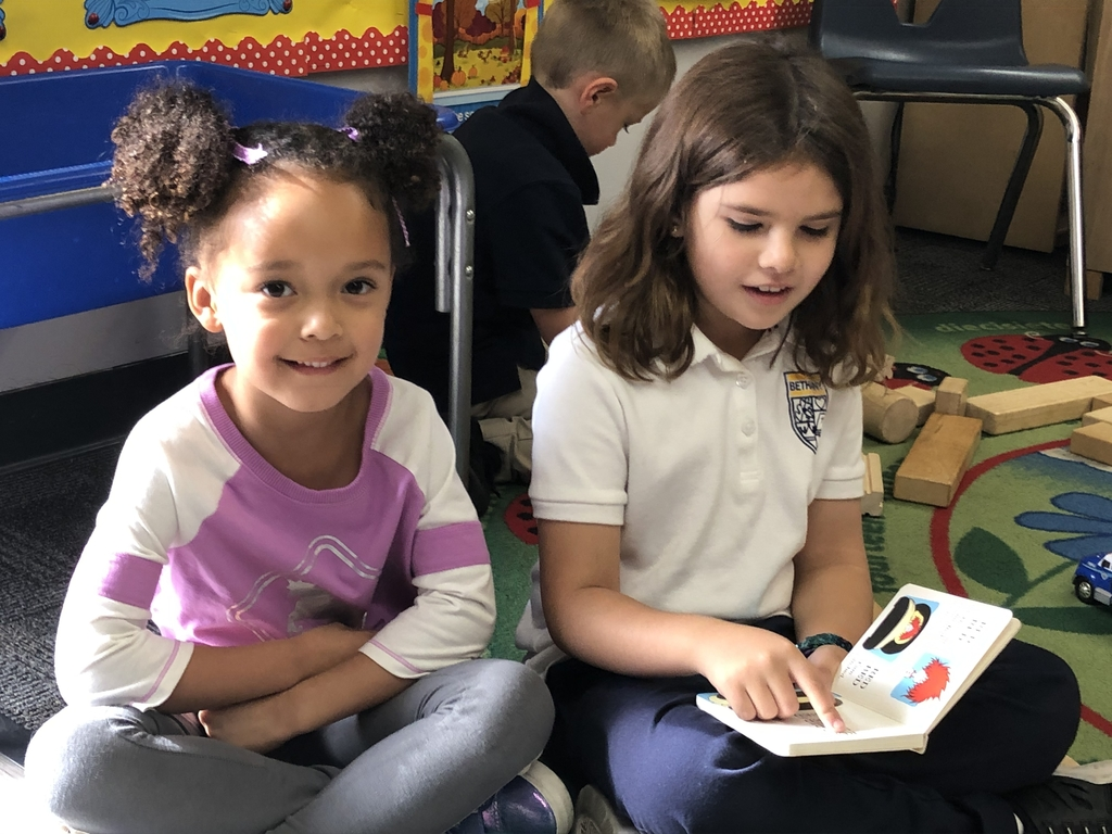 First grade helped TK by reading t on their Ladybug buddies.